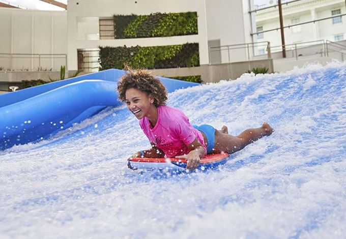 girl on flowrider at-Soundwaves-at-gaylord-opryland-nashville